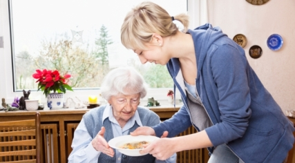 Caregiver-helping-senior-lady-in-her-home-small
